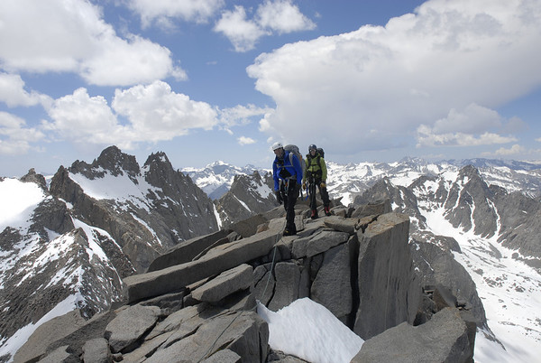 Chuck and Dusty nearing the classic summit of Mt. Sill with a breathtaking view of the Sierra all around.